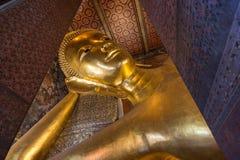 Reclining Buddha at the Wat Pho temple Royalty Free Stock Photo