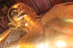 Reclining Buddha at Wat Pho or Wat Phra Chettuphon Wimon Mangkhl. Aram Ratchaworamahawihan or Temple of the Reclining Buddha, one of famous landmarks in Bangkok Royalty Free Stock Image