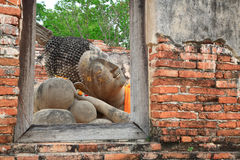 Reclining Buddha  from window frame in Ayutthaya Stock Photos
