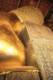 Reclining Budhha. Reclining Buddha from behind shoulder and head on pillow Stock Image