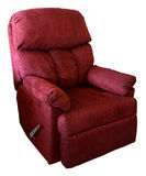 Reclining Chair. Plush Rocking Reclining Chair in a Burgundy Fabric Stock Photo