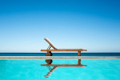 Reclining chair near a swimming pool Stock Photo