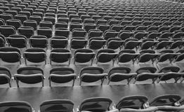 Reclining chairs on the stadium bleachers with nobody. Lots of reclining chairs on the stadium bleachers with no people before the sporting event Stock Photos