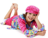 Reclining Flower Child. Portrait of a happy preteen girl reclined in colorful hippie attire Stock Image