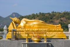 Reclining gold Buddha Stock Images