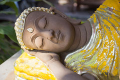 Reclining gold buddha statue. Reclining gold buddha sculpture statue Stock Photo