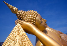 Reclining golden buddha Stock Image