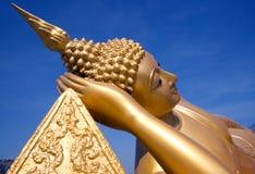 Reclining golden buddha Stock Image