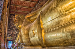 Reclining Golden Buddha image. In Bangkok, Thailand Stock Photo