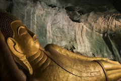 Reclining Golden Buddha In The Cave Royalty Free Stock Photo