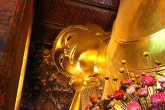 Reclining golden buddha statue Stock Image