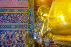 Reclining golden Buddha statue with thai art architecture in church Wat Pho Royalty Free Stock Photography