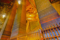 Reclining golden Buddha statue with thai art architecture in church Wat Pho Stock Photo