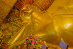 Reclining golden Buddha statue with thai art architecture in church Wat Pho Royalty Free Stock Images