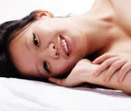 Reclining Portrait Of Beautiful Chinese Woman Smiling Stock Images