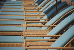 Reclining Wicker Chaise lounge chairs. A set of Wicker reclining lounge chaise chairs royalty free stock image
