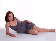 Reclining Young Woman In Dress. Young Woman Reclining In Dress Royalty Free Stock Photography