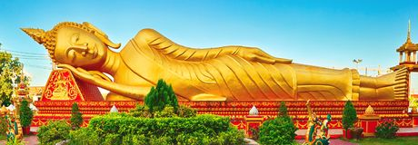 Reclning Buddha. Vientiane, Laos. Panorama. Reclning Buddha at Pha That temple. Vientiane, Laos. Panorama stock images