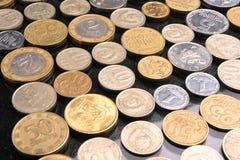 Recogida de monedas Fotografía de archivo libre de regalías