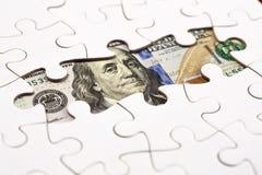 Recogida del billete de banco del dólar con el rompecabezas Imágenes de archivo libres de regalías