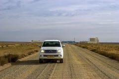 Recogida del vehículo en el desierto fotografía de archivo libre de regalías