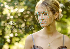 Recognition of female face. Biometric verification and identification. Recognition of a female face by layering a mesh and the calculation of the personal data royalty free stock image