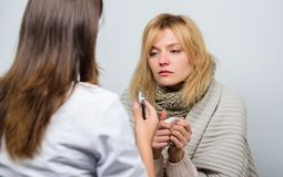 Recognize symptoms of cold. Medical examination. Doctor and patient concept. Adult fever symptoms. Treatment and when to. Call doctor. Doctor woman examine sick stock photos