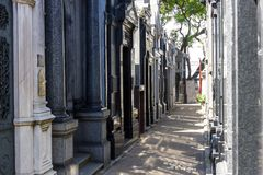 Recoleta cemetery in Buenos Aires narrow passage with shadow. In summer royalty free stock photography