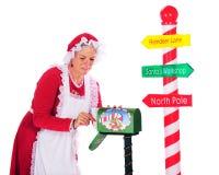 Recolhendo o correio de Santa Imagem de Stock Royalty Free