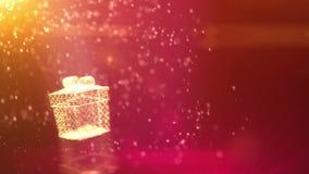 Recolhimento mágico das partículas em uma caixa de presente do Natal Animação 3d dando laços video estoque