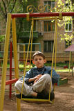 Recollect childhood. The teenager on a swing Stock Photo