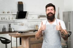 Recommend nice recipe. Culinary business. Brutal confident chef in restaurant. Hipster bearded masculine chef cooking. Food in kitchen. Cuisine for real men stock image