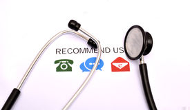 Recommend us icons with medical stethoscope on top Stock Photos