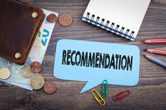 Recommendation concept. Speech Bubble on a dark textured wooden background Stock Photo