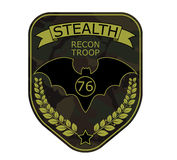 Recon troop military emblem patch with bat, ribbon, star and branch Stock Photos
