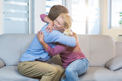 Reconciled couple hugging Royalty Free Stock Images