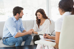Reconciled couple smiling at each other Stock Photos