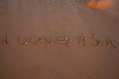 Reconnaissance sur le sable je t'aime Photographie stock libre de droits