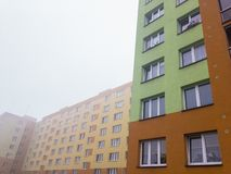 Reconstructed blocks of flats in Czech Republic built in communism era. In misty weather stock photos