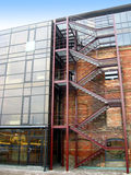 Reconstructed building. Old red block building, combined with the steel and glass constructions Stock Photography