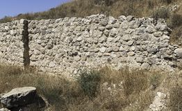 Reconstructed City Wall at Tel Lachish in the Judean Hills in Israel. Ruins and partial reconstruction of a stone wall at Tel Lachish in the Judean Hills near stock photos