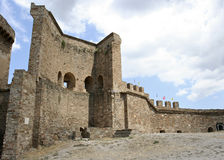 The reconstructed stony wall and the fragment of the tower in the medieval Genoese fortress. Stock Photography