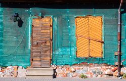 Reconstruction. Reconstruction. An old wooden cottage wrapped up in a net as protection Royalty Free Stock Image