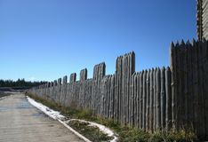 Reconstruction of an ancient fence and a road made of wood royalty free stock photography