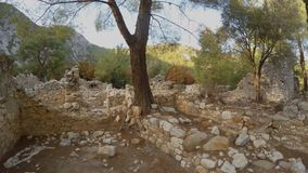 Reconstruction in the city of the times of antiquity, the Lycian kingdom, forbidden archeology. Ruins of the ancient city of Olympos, Lycian trail, Roman burials stock footage