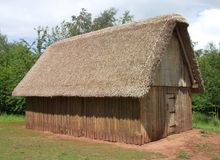 Reconstruction of Dark Ages Anglo-Saxon hall. Reconstruction of Dark Ages Anglo-Saxon thatched wooden hall, built at Bishops Wood Centre, Worcestershire, England royalty free stock photos