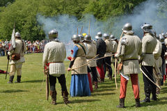 Reconstruction in historical costumes on field of battle Royalty Free Stock Photo