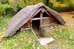 Reconstruction of Iron Age Celtic pit-house stock photo
