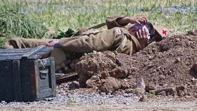 The orderly makes dressing the wounded soldier on the battlefield royalty free stock photos