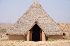 Reconstruction of Neolithic House. In the neolithic, the semi-subterranean mud  houses started appearing Royalty Free Stock Photos